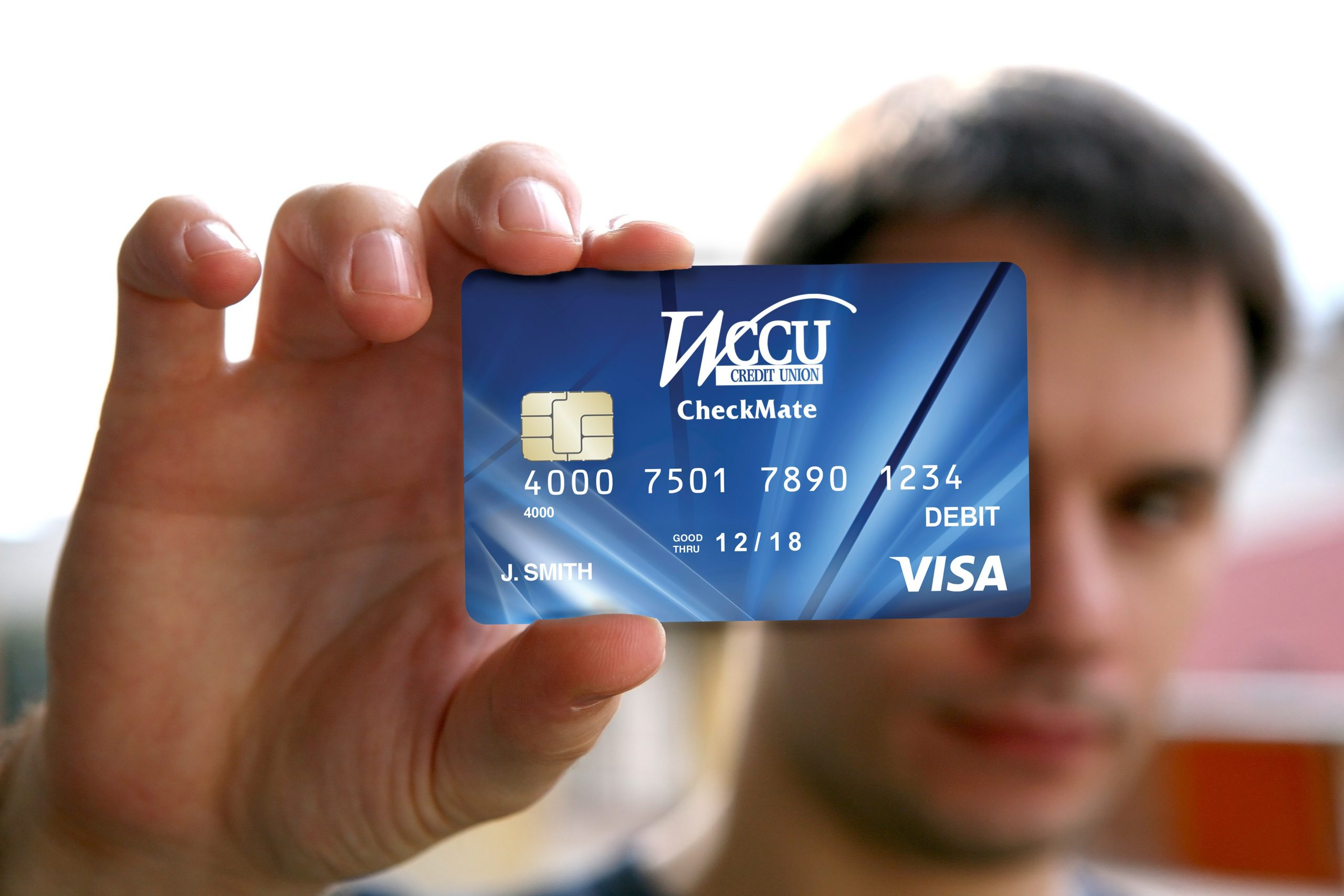 holding deposit form  man holding a blank id card with chip – WCCU Credit Union - holding deposit form